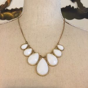 White faceted tear drop gold tone chain necklace